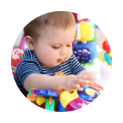 infant boy playing toys