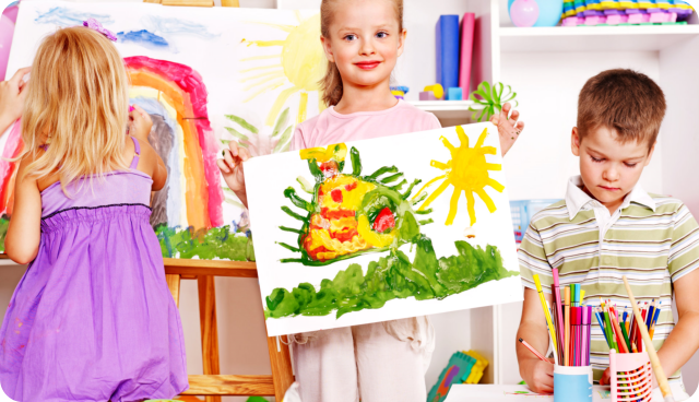 young girl presenting her painting