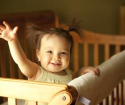 little girl raising his hand